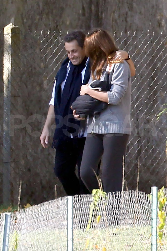 Carla Bruni and Nicolas Sarkozy went for a stroll with newborn Giulia Sarkozy.