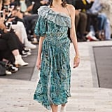 We'd dare her to try something of the same color scheme, but in a more striking silhouette. Michelle loves to show off her arms, and this one-shoulder design would definitely do her justice. Preen Spring 2017.