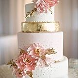 This beauty is practically blooming with pink petals and flecks of gold detail that are both timeless and tasteful.