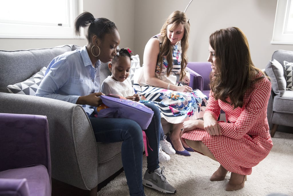 """The Duchess of Cambridge is getting a head start on celebrating Mother's Day this year. The Duchess of Cambridge and proud mum was greeted warmly at London's Royal College of Obstetricians and Gynecologists on Thursday for a launch of educational films dealing with maternal mental health. The films were created by Best Beginnings, a charity partner of Kate, Prince William, and Prince Harry's Heads Together Campaign. Once inside, Kate commented on the tragic terrorist attack in London that claimed four lives and injured dozens more on Wednesday. """"Before I begin, I know you would all want to join me in sending our thoughts and prayers to all those sadly affected by yesterday's terrible attack in Westminster,"""" she said. """"We will be thinking of all the families, as we discuss the important issues we're here to talk about."""" After discussing the terror attack, Kate continued with her planned speech that addresses the various mental health challenges that new mothers face. """"Personally, becoming a mother has been such a rewarding and wonderful experience,"""" she said. """"However, at times it has also been a huge challenge — even for me who has support at home that most mothers do not. Nothing can really prepare you for the sheer overwhelming experience of what it means to become a mother. It is full of complex emotions of joy, exhaustion, love, and worry, all mixed together. Your fundamental identity changes overnight. You go from thinking of yourself as primarily an individual, to suddenly being a mother, first and foremost."""" The princess hopes to start positive, life-changing conversations about the well-being of parents and their children. Thanks to all of her hard work with William and Harry in the arena of mental health over the last few years, the royal family is shining a light on topics that so frequently get pushed under the rug. """"There is no rule book, no right or wrong — you just have to make it up and do the very best you can to care for your family,"""" she continued."""