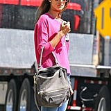 Alessandra Ambrosio sported a pink sweater.
