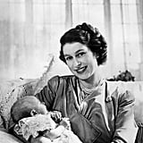 Still a princess and heir apparent, Elizabeth posed casually with a baby Princess Anne in 1953.