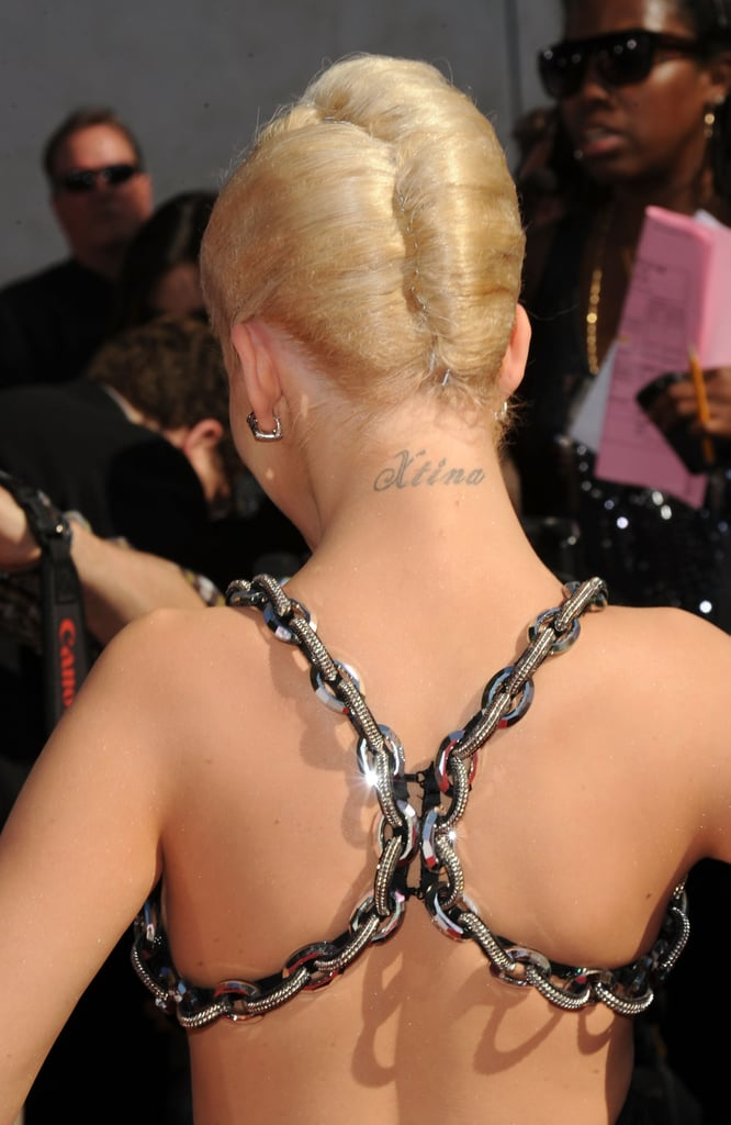 Her nickname, Xtina, is tattooed on the back of her neck.