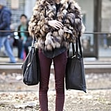 The model uniform: skinnies, combat boots, and a luxe fur chubby.