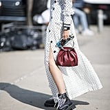 If your polka-dots are feeling too feminine? Combat boots and a modern bag are the answer.