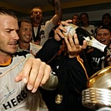 David Beckham watched his teammate pour champagne into their freshly-acquired MLS cup.