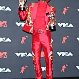 All red everything. Lil Nas X switched up his look at the 2019 VMAs in this red suit and cowboy hat while collecting his first-ever awards from the iconic MTV awards show.
