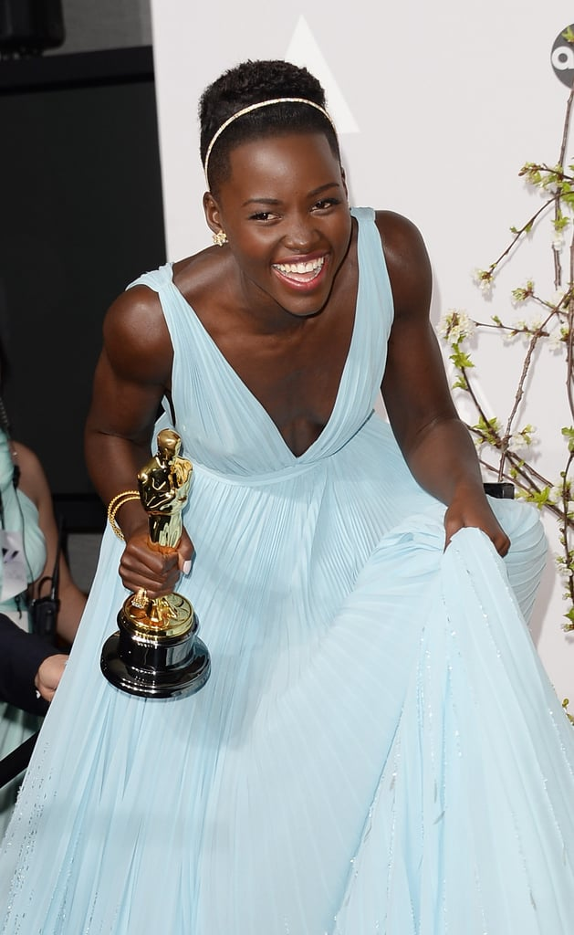 Nyong'o cracked up with her statue.