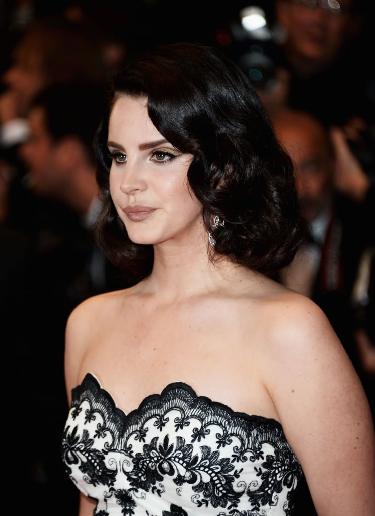 Singer Lana Del Rey didn't stray too far from her favorite vintage beauty look. At the premiere of The Great Gatsby, she wore tight curls and golden eye makeup with a nude lip look.