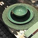 "On the tabletop, various shades and textures of teal look elegant and are the perfect backdrop for a bolder print. Nancy explained, ""When using bold prints in your home, it's best to have a balance of tonal solids so your prints can stand out."""