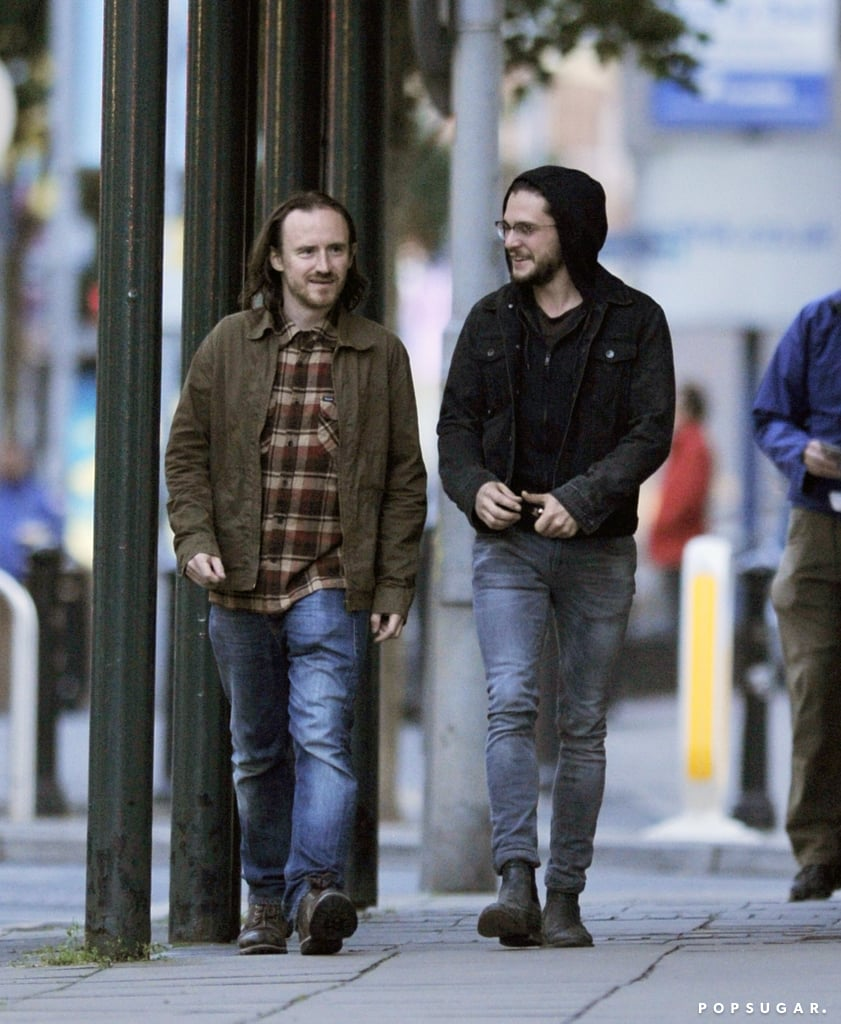 Is this good news for Game of Thrones fans?! Kit Harington, who plays Jon Snow on the series, was spotted in Belfast, Ireland — one of the show's filming locations — on Tuesday. The actor was all smiles, laughing alongside his Game of Thrones costar Ben Crompton, who plays Eddison Tollett. Although Kit's signature long locks were covered with his hood, he and his long hair did make an appearance at Wimbledon in early July. Does this clear up the doubt over Jon Snow's death in the season five finale? Well, to be fair, if the character died, they'd possibly still need Kit to shoot a few scenes — maybe some sort of funeral or an extension of that heartbreaking final scene. In any case, keep reading to see more pictures of Kit Harington out and about in Northern Ireland, then find out how season five confirmed who Jon Snow's real parents are and check out theories about how Jon Snow will return to Game of Thrones.