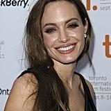 Angelina Jolie accompanied Brad Pitt to the Moneyball premiere.