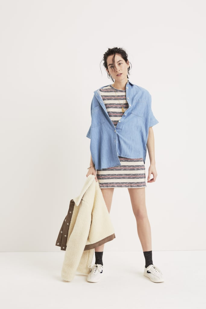 An oversize button-down shirt balances out a tight minidress.