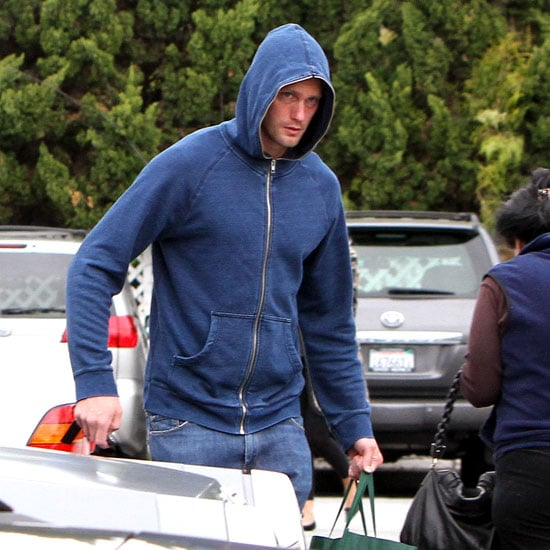 Alexander Skarsgard took refuge from the rain in LA on Saturday with the help of his blue hoodie. He was out running errands solo after a busy week of meeting up with his friends and sticking to his intense gym routine. Alexander has also hit the town to support his lady friend Kate Bosworth, who's been focusing on her blossoming jewelry business. Alex is gearing up for the June debut of his HBO series True Blood, which promises to show off the fruits of his labor at the gym.