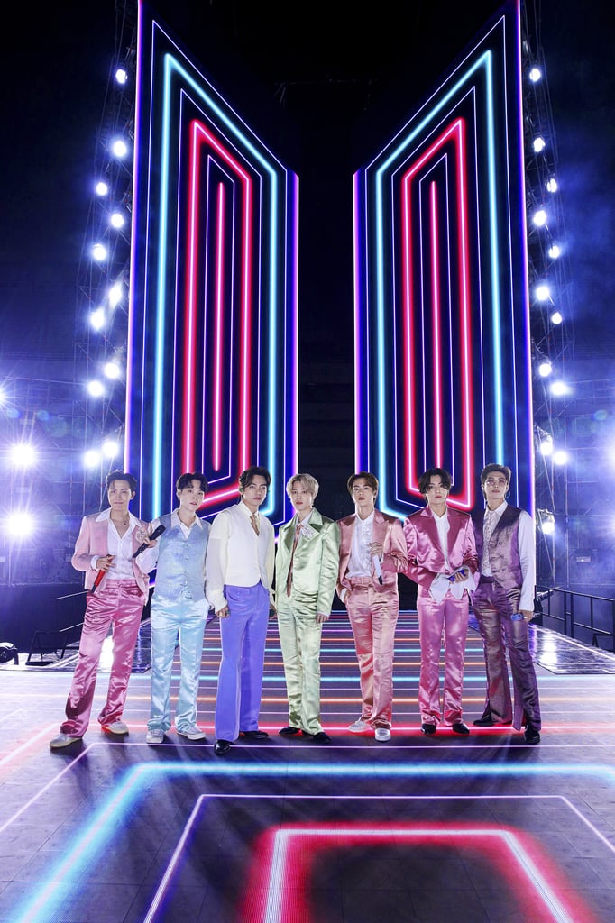"BTS always manage to look both dashing and perfectly coordinated at every award show, but the septet upped their game for the American Music Awards on Sunday night. The boy band first stepped on stage in chic black-and-white ensembles to sing their newest hit, ""Life Goes On,"" then quickly changed into colorful satin suits with flared pants for their vibrant performance of ""Dynamite."" We love a coordinated moment, and the retro looks curated for each member made their set all the more fun.  Wearing bright shades of pink, purple, green, and blue, this year's favorite pop group gave an epic performance. BTS's ARMY will remember the crew also wore rainbow pastel outfits in their ""Dynamite"" music video, but the striking satin certainly takes things to the next level. Get a closer look at BTS's immaculate looks ahead."