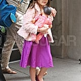 Suri Cruise with her doll.