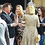 Kate Moss visited with guests.