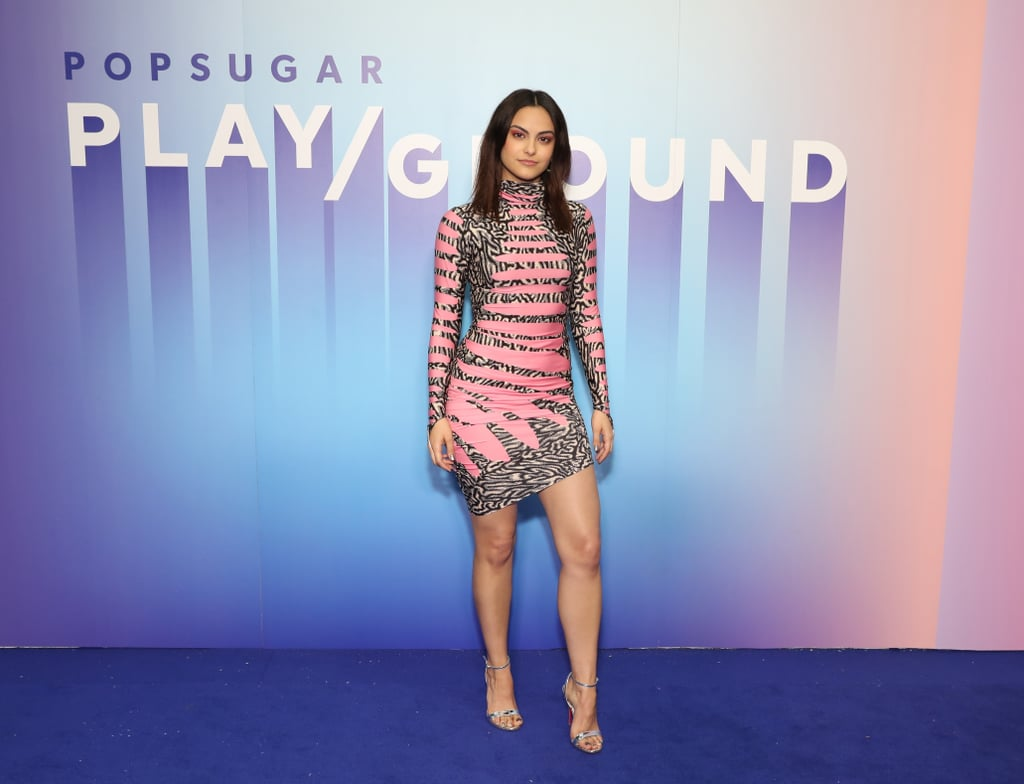 Camila Mendes's latest neon look is straight out of our wildest dreams. The 24-year-old Riverdale actress attended POPSUGAR Play/Ground in NYC on June 22, and her eye-catching Maisie Wilen dress stood out on the blue carpet. As Camila talked with model Candice Huffine, we zeroed in on every detail of her outfit — from her metallic silver shoes to her bubblegum pink purse. As the neon trend has picked up steam over the past few months, we've seen other celebrities in similarly bright and bold looks from Maisie Wilen; Kendall Jenner wore a skirt from the designer just two days prior. Camila's own jersey turtleneck dress featured a black-and-white pattern, alternating over peeks of bright pink. We think it's fair to call this dress an optical illusion of the best kind! Keep reading to get a closer look at Camila's Play/Ground crazy cool outfit.