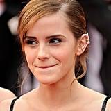 Emma Watson accessorised with three ear cuffs.