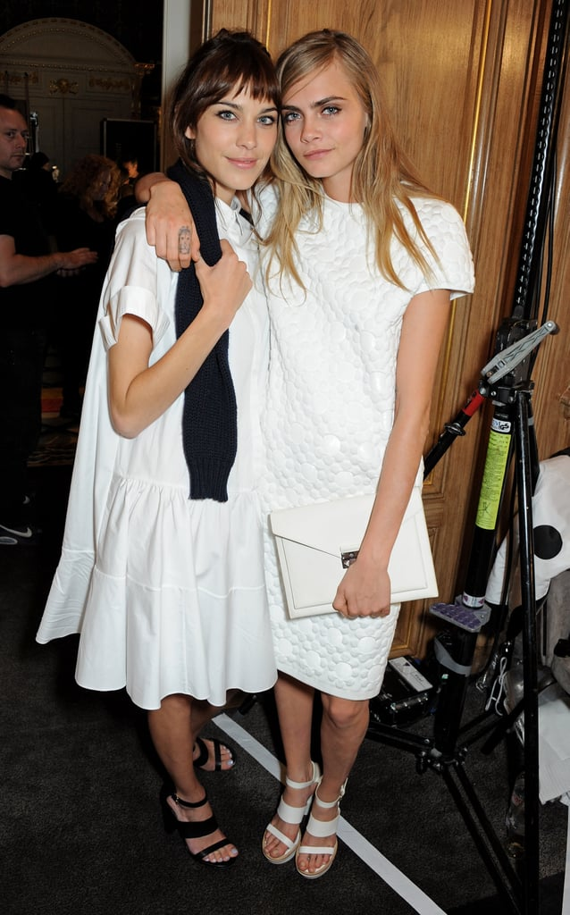 Cara Delevingne buddied up with Alexa Chung backstage at the Mulberry show.