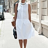 A white shirt dress with flat shoes