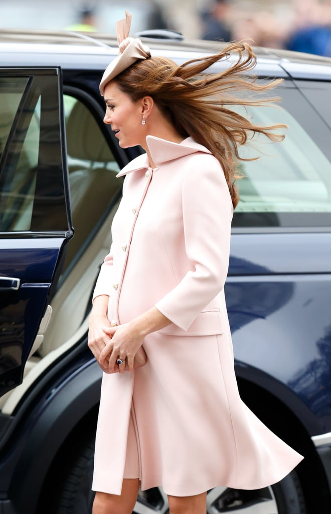 In March 2015, a very pregnant Kate — who was expecting Princess Charlotte at the time — covered her bump in a pale pink Alexander McQueen coat for church service at Westminster Abbey (on a significantly windy day).
