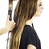 Starting about three-quarters of the way up your strands, loosely curl all your hair using a curling iron like GHD Curve Soft Curl Iron ($199). There's no need to be careful about the size of the sections or direction of the ringlet! This style will look cooler if it's a bit messy.