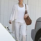 And her most dressed-down white look? This combo of t-shirt, sweatpants, and open-front cardigan. The only color breaking things up was the warm brown of her bag.