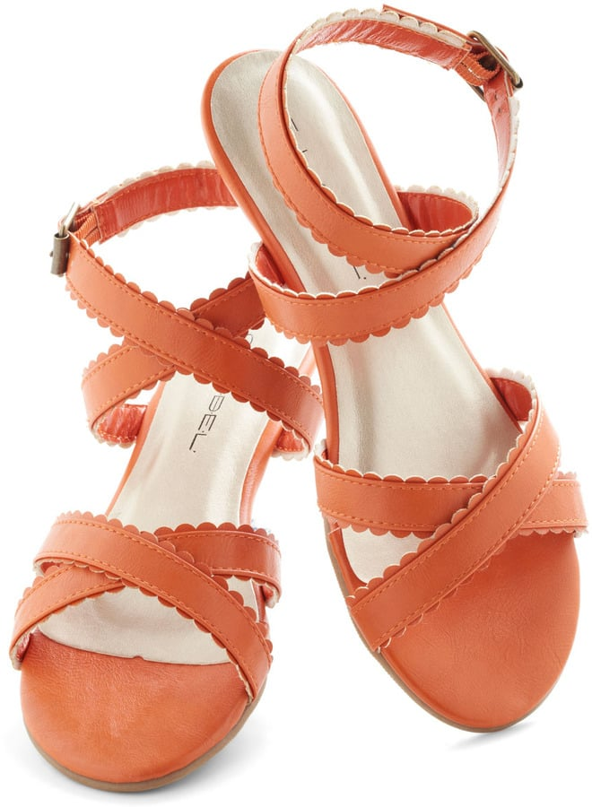 Pretty scalloped detailing on these ModCloth flats ($35) offers a girlie touch.