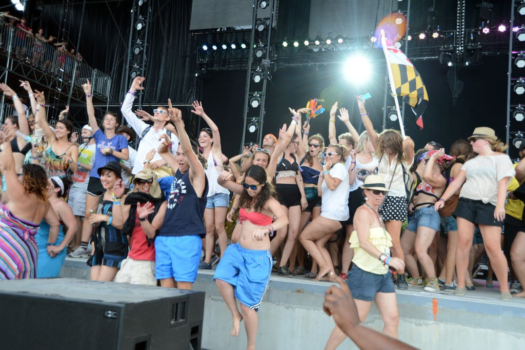 The crowd rushing the stage during Santigold in 2012.