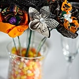 Filling a vase with candy corn can double as decor and treats for your guests.