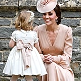 Kate took a moment during Pippa's wedding to smile adoringly at Charlotte.