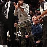 Jay-Z cheered at the Knicks vs Nets game in NYC.