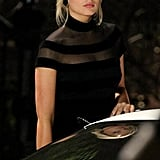 Margot Robbie wore a black dress on set.