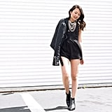 A Leather Jacket, Black Romper, Booties, and a Statement Necklace
