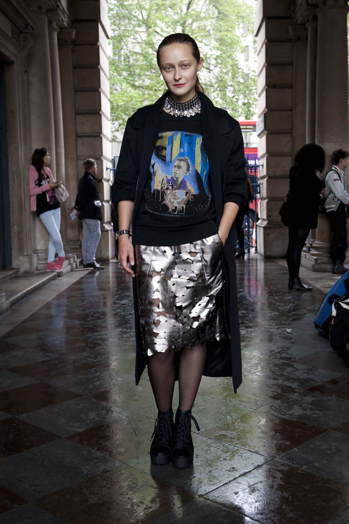 Mismatched-cool, thanks to her graphic tee and metallic pencil skirt.