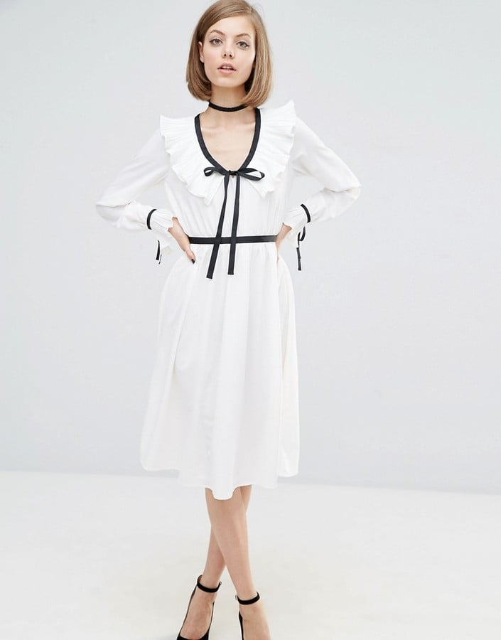 The Dress: Lost Ink Contrast Trim Dress With Frill Detail ($68)  The Costume: Coco Chanel, Kirsten Dunst in The Virgin Suicides, or a French maid with an apron.