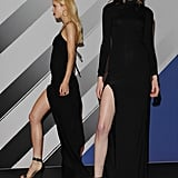 Two variations on the long black dress with thigh-high slits, according to the Rihanna For River Island Fall 2013 collection.