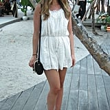 A feminine look comprised a white Zimmermann playsuit and nude wedges.