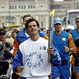 He showed off his sporty side for the Athens 2004 Olympic torch relay in Stockholm.