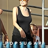 She wore a black tank top while visiting the amusement park in Sydney.