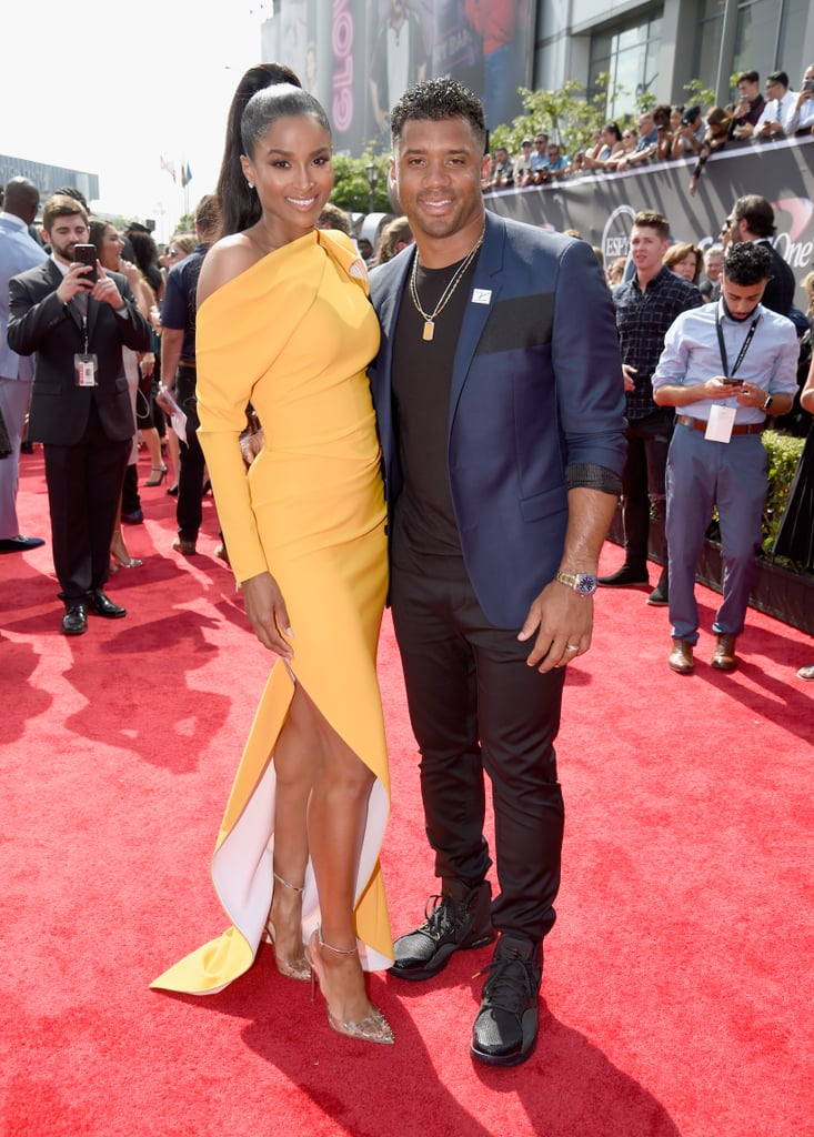 "Ciara and Russell Wilson arrived in style to the 2018 ESPY Awards in LA on Wednesday night. The couple nearly set the red carpet on fire as Ciara showed off major leg in a high-slit yellow dress whilst Russell looked dapper in a navy blazer. Ciara and Russell have been regulars at the sports ceremony since they first got together; however, we missed them last year. While Russell is set to present an award tonight, it's also a big night for Ciara, as she's celebrating the release of her new single, ""Level Up."" As if that weren't enough, the couple also rang in their two-year wedding anniversary on July 6. See photos from their night out ahead."