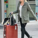 Diane Kruger wore a green jacket to wheel her suitcase out of her hotel in NYC.