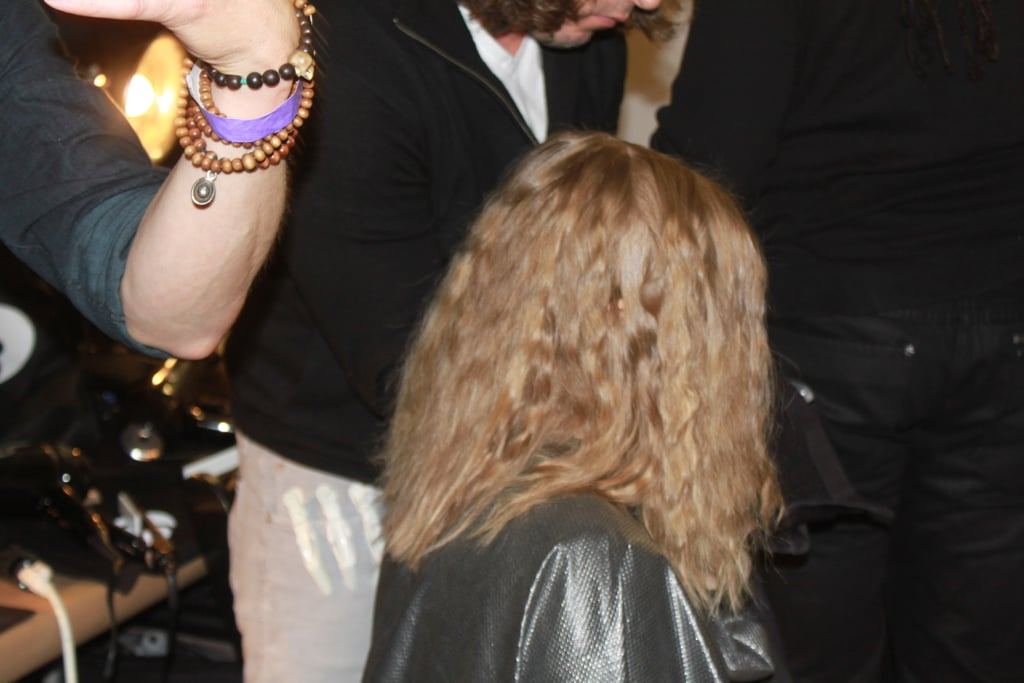 "Once cool, hair was released and brushed out to form textured waves that were then secured behind each ear. ""The look here is bohemian minimalism. There are a lot of architectural shapes and a lot of texture in the fabrics that he used in the collection,"" Pita said. ""So we tried to get that in the hair, so we're playing with the really defined and the kind of romantic bohemian."""