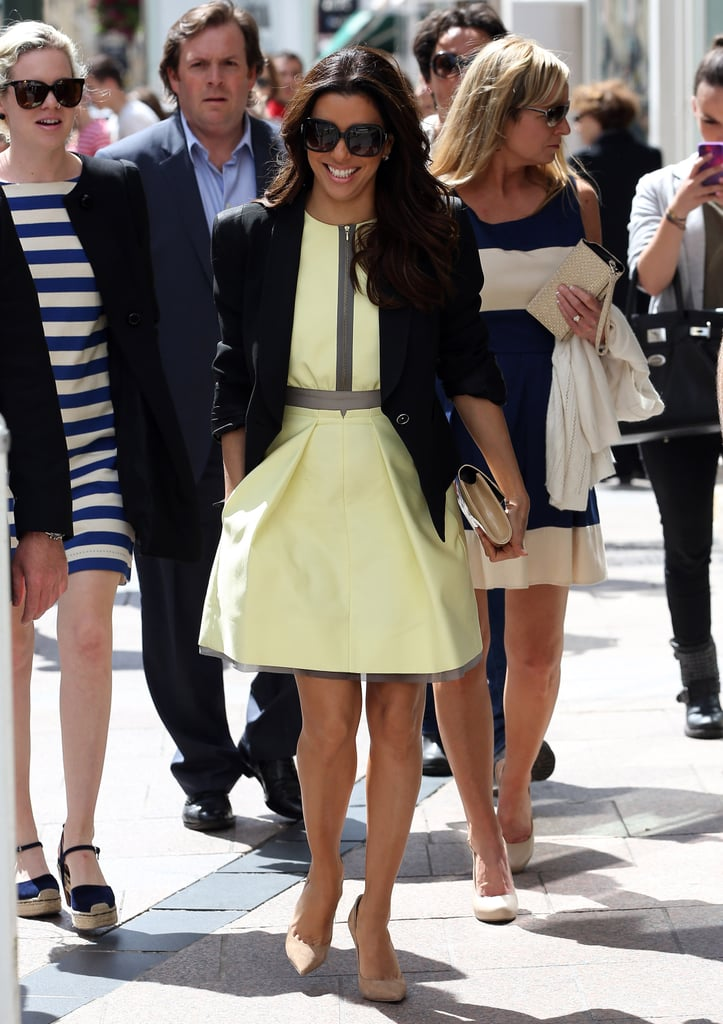 Eva Longoria strolled the streets of Cannes in a spunky yellow fit-and-flare dress, tempered via a black blazer, nude pumps, and Salvatore Ferragamo sunglasses.