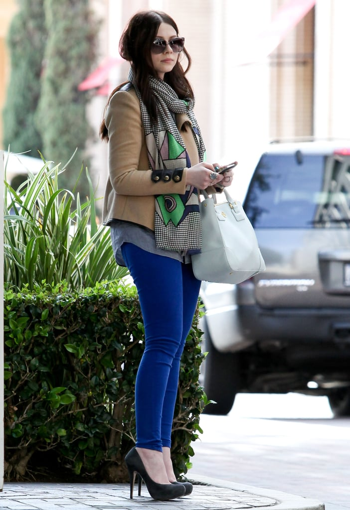 Michelle Trachtenberg sported bright blue skinny jeans and a lightweight printed scarf while leaving a meeting in LA.