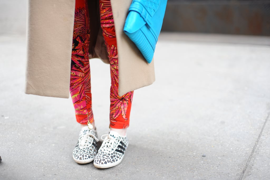 Spotted print on these Adidas kicks played right off of her printed trousers.