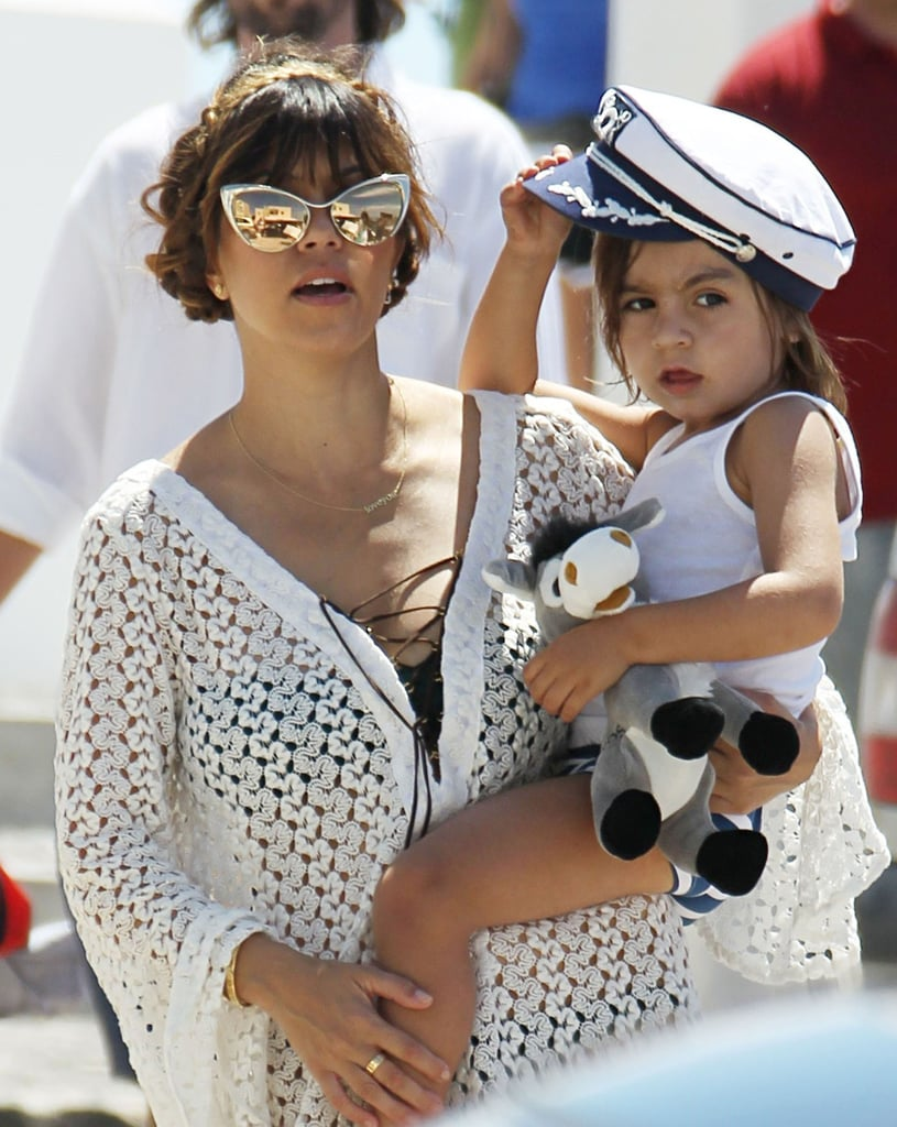 Kourtney Kardashian carried her little Grecian sailor while vacationing with her family in Santorini on Monday.
