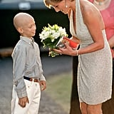 Diana accepted flowers from a young boy at the Serpentine Gallery Summer Party in June 1995.