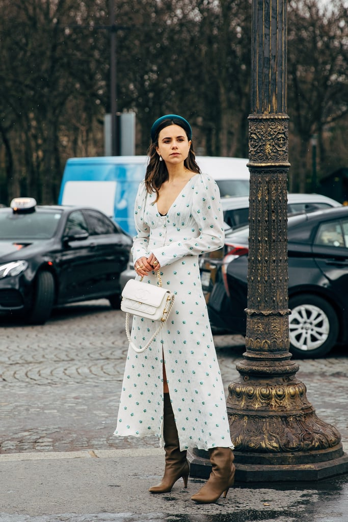 Take your maxi dress to the next level by simply adding a pair of heeled boots.